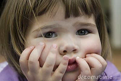 Cute little girl holding face