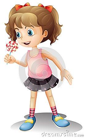 A cute little girl holding a lollipop