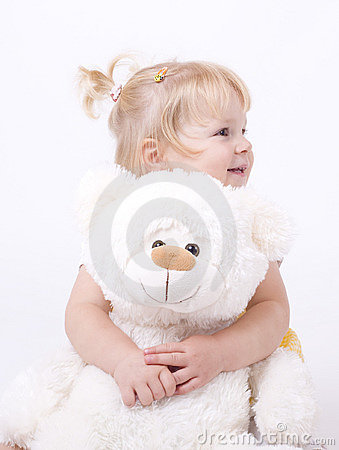 Cute little girl hugging teddybear