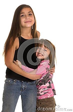 Cute little girl hugs older friend