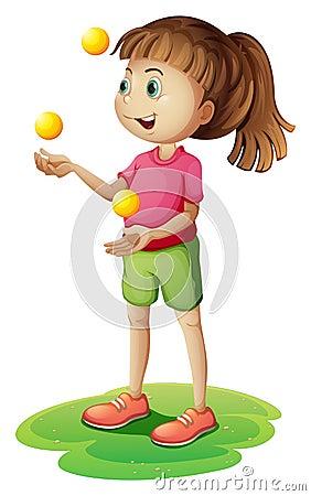 A cute little girl juggling