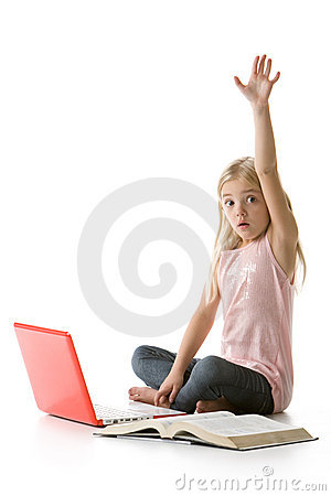 Cute little girl with laptop, raising her hand