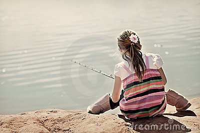 Cute little girl learning to fish