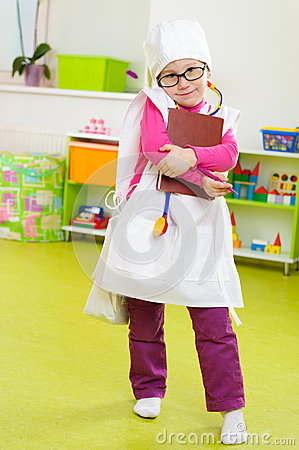 Cute little girl playing in doctor