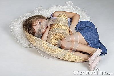 Cute little girl in a mexican big hat, sumbrero
