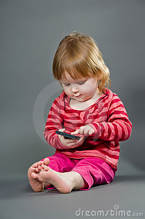 Cute little girl with mobile phone