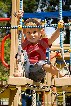 Free Cute Little Girl On A Playground Stock Images - 10391034