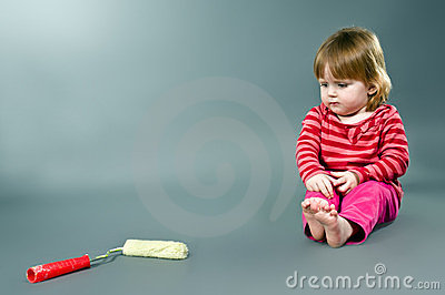 Cute little girl with paint roller