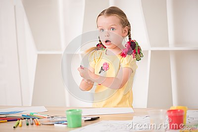 Cute little girl painting