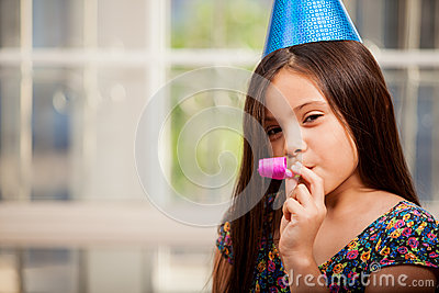 Cute little girl in a party hat