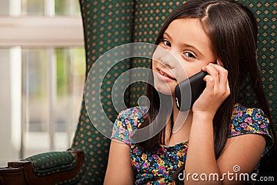 Cute little girl on the phone