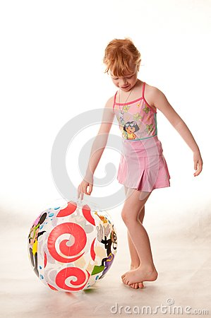 Cute little girl in pink swimsuit