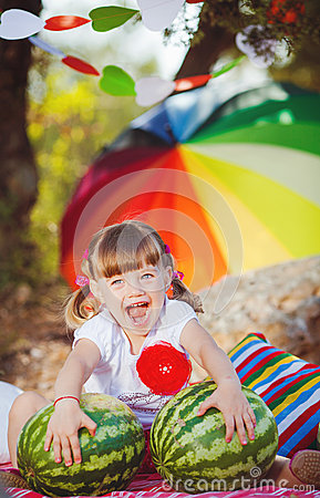Cute little girl playing in summer park. Outdoor