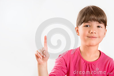Cute little girl pointing on copy space