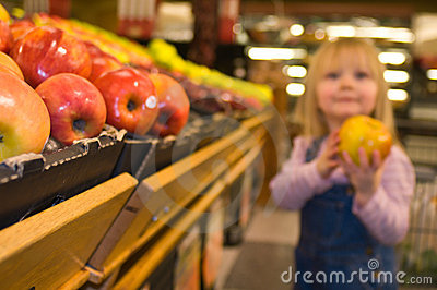 Cute Little Girl in the Produce Section