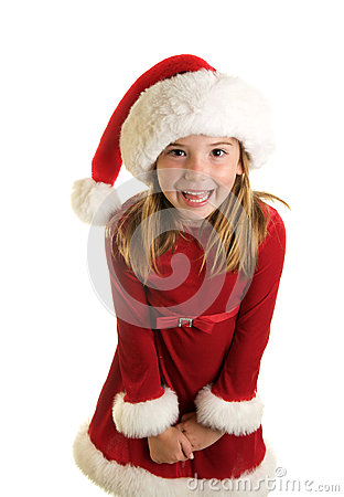 Cute little girl with a red christmas dress and santa hat on a white
