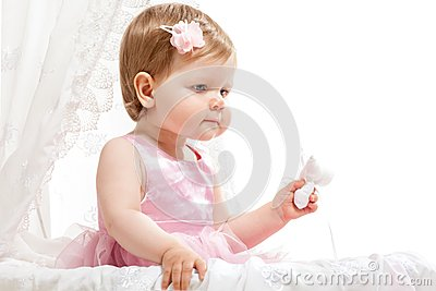 Cute little girl sitting in baby buggy