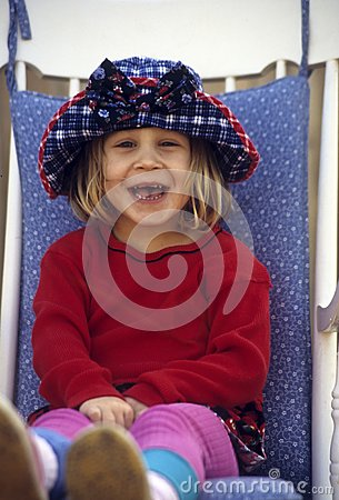 Cute little girl sitting in chair