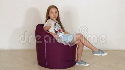 Terrific Cute Little Girl Sitting On Purple Bean Bag Sofa For Living Room Slow Motion Person Background Andrewgaddart Wooden Chair Designs For Living Room Andrewgaddartcom