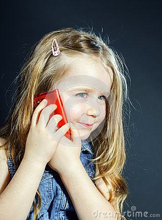 Free Cute Little Girl Speaks Using New Cell Phone. Stock Photo - 48604540