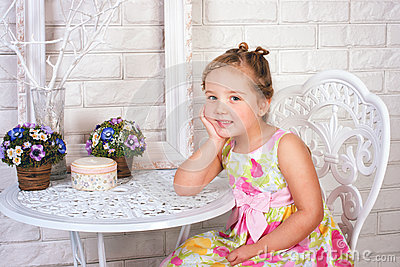 Cute little girl  with spring flowers
