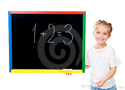 Cute little girl standing near blackboard