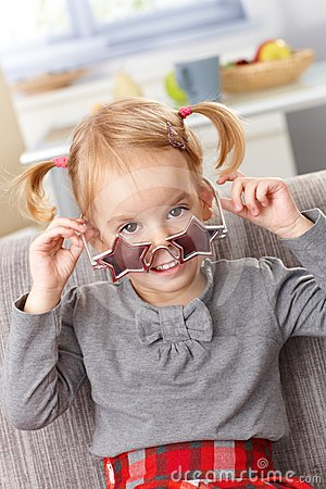 Cute little girl with star shaped glasses smiling