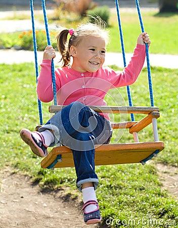 Cute little girl on swing