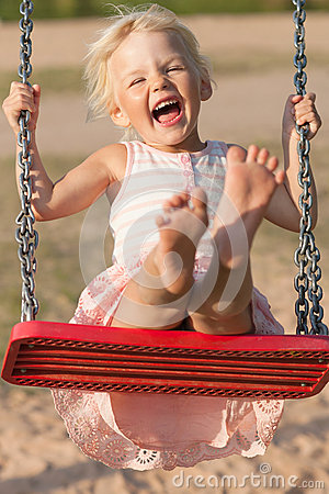 Cute little girl swinging