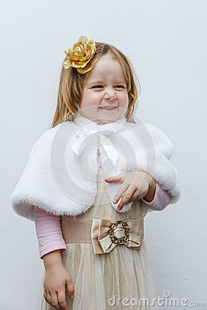 Cute little girl trying on dress