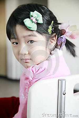 Cute little girl turning back