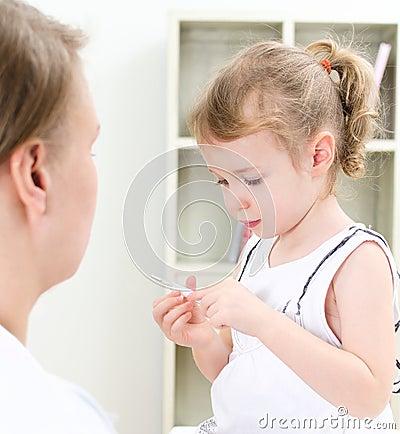 Cute little girl visiting pediatrician