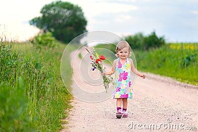 Cute little girl walking on the road
