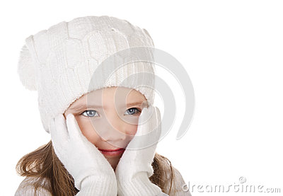 Cute little girl in warm hat and gloves closing her cheks isolat