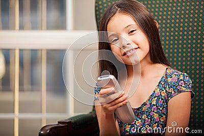 Cute little girl watching TV