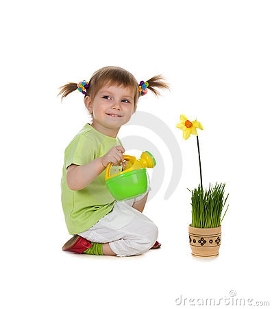 Cute little girl watering the flower