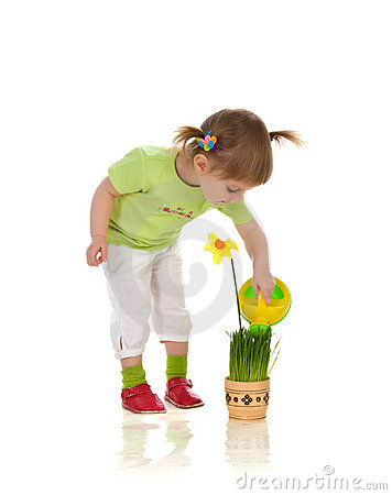Cute little girl watering flower