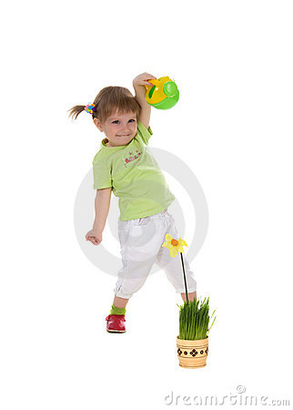 Cute little girl watering yellow flower
