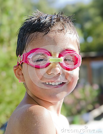 Free Cute Little Kid With Goggles Laughing In Pool Stock Image - 32683111