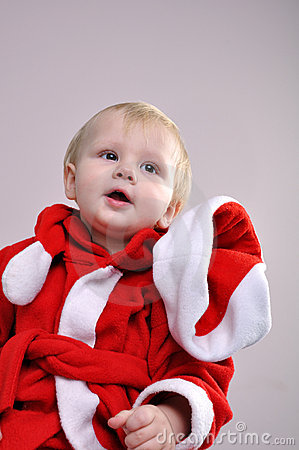 Cute little smiling Santa toddler boy