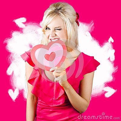 Free Cute Love Hungry Girl Eating Big Red Heart Royalty Free Stock Photo - 31333335