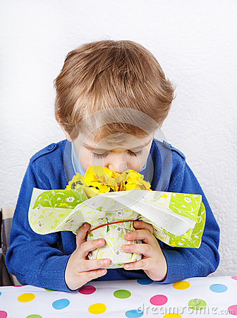 Free Cute Lovely Toddler Boy Of 3 Years Sniffing Yellow Flowers For M Stock Photos - 36464173