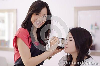 Cute makeup artist at work