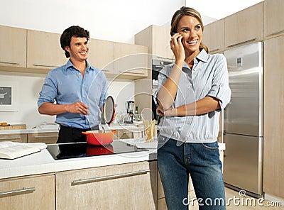 Cute mature couple preparing food