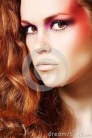 Cute model with fantasy fashion make-up, long hair