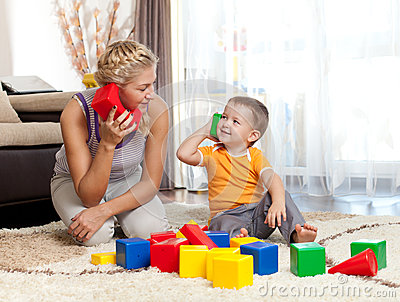 Cute mother and kid boy playing together