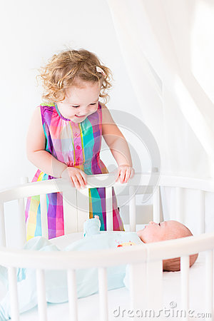 Free Cute Newborn Baby Boy Looking At His Toddler Sister Royalty Free Stock Photos - 41587918