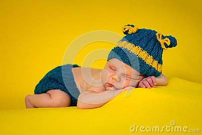 Cute newborn on yellow blanket