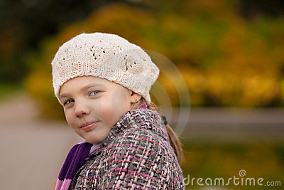 Cute nice girl in white beret smiling