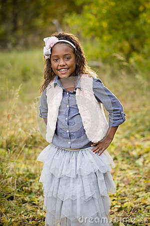 Free Cute Outdoor Portrait Of A Smiling African American Little Girl Royalty Free Stock Photo - 60360285